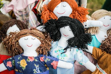 girl doll: colorful sewed handmade dolls on a fair Stock Photo