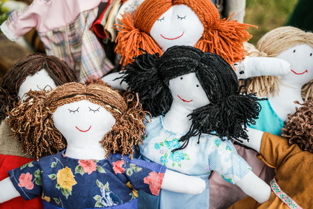 colorful sewed handmade dolls on a fair Stockfoto