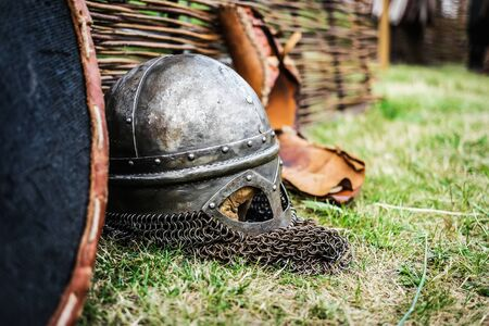 chain armour: steel knight helmet with chain armour on grass