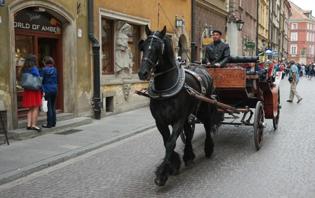 the coachman: Warsaw, Poland - june 20, 2015: carriage on Warsaw street in historic part of the city