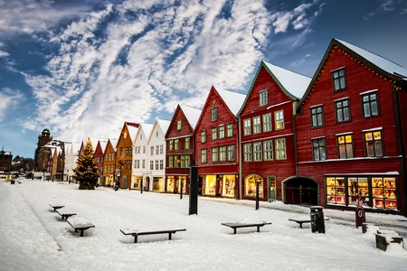 europe: Famous Bryggen street with wooden colored houses in Bergen at Christmas, Norway