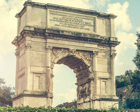 winning location: view on The Arch of Constantine is a triumphal arch in Rome near Coliseum