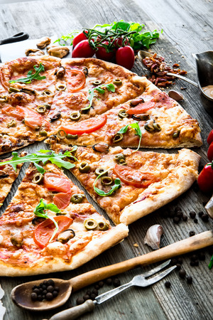 delicious pizza with seafood on wooden table Banco de Imagens