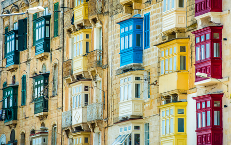 street with colorful balconies in historical part of Valletta in Malta