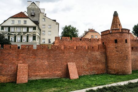 outpost: fortified medieval outpost Barbakan in Warsaw in Poland Stock Photo