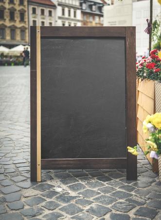 outdoor restaurant: menu advertising board near an eatery