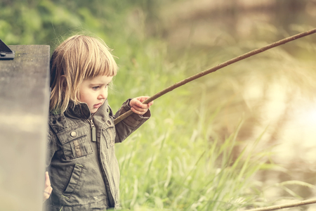 looking after: fisher girl carefully looking after the fishing rod