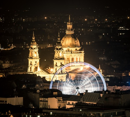 basilica: night view on Cupola and ferris wheel in Budapest