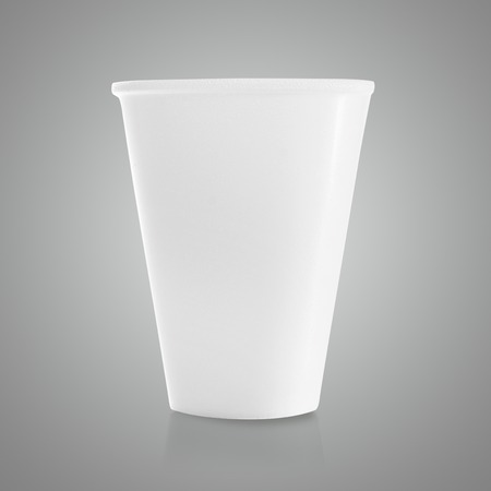 isolated  on white: plastic cup on gray background