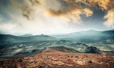 timanfaya: beautiful mountain landscape with volcanoes at sunset in Timanfaya National Park in Lanzarote, Canary Islands