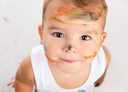 white color: cheerful little boy with painted face portrait Stock Photo