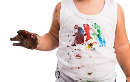 kids painted hands: close-up of kids painted white shirt and hand Stock Photo