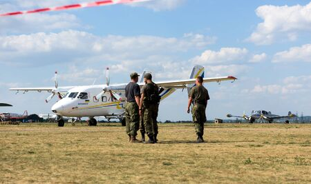 airfield: Kharkiv, Ukraine - August 24, 2015: soldiers and plane on airfield Korotych at Kharkiv airshow Editorial