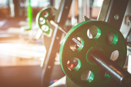 weightlifting equipment: Rod with weights in the gym