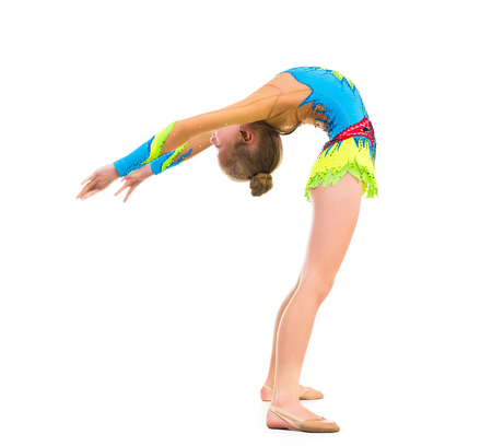 girl legs: tittle gymnast doing stretching exercise isolated on white background Stock Photo