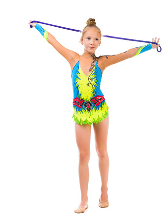jump suit: little gymnast holding a skipping rope over her head isolated on white background Stock Photo