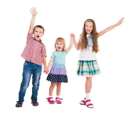 kids hand: three children with hands up isolated on white background