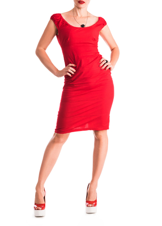 red dress: girl`s figure in red dress with hands on the sides Stock Photo