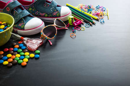 glasses eye: kids stuff and sweets on a white background