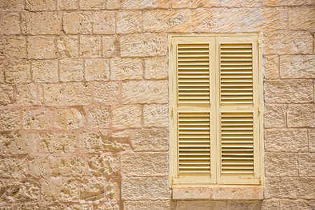 antique background: traditional window with shutter in Maltese Mdina Stock Photo