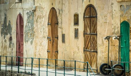 vibrant cottage: street with colorful gates in Vallatta historical center in Malta