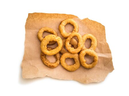 onion rings: onion rings on parchment isolated on a white background