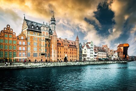 Cityscape on the Vistula River in historic city of Gdansk at sunset  in Poland