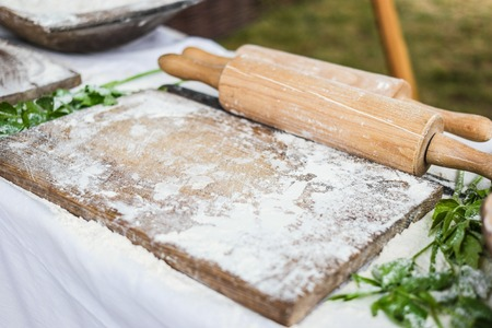 rollingpin: working surface for dough with wooden board and rolling-pin Stock Photo