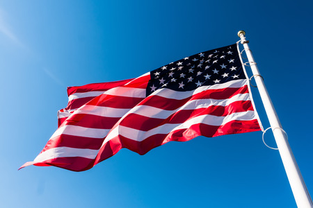 united states flag: american flag waving in blue sky