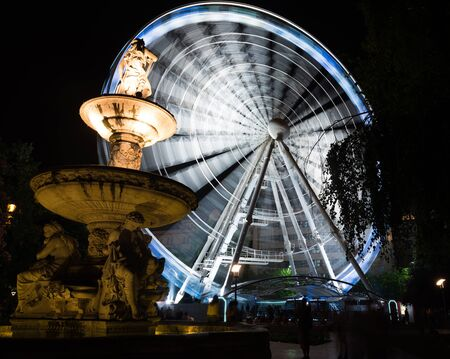 ferriswheel: night park with ferris wheel and fountain in Budapest