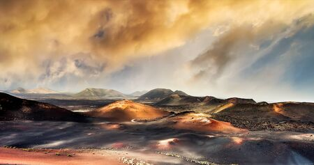 timanfaya: beautiful mountain landscape with volcanoes in at sunset Timanfaya National Park in Lanzarote, Canary Islands