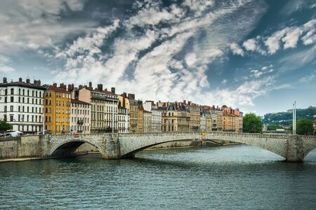 sone: view from river Sona to the Bonaparte bridge and Lyon city against sky, France Stock Photo