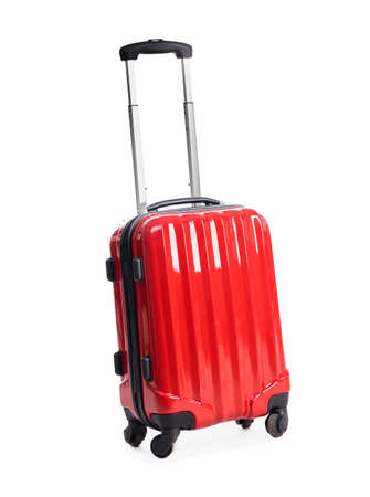 carry on: red suitcase isolated on white background