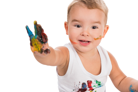 funny boy: funny little boy with colored hand and face isolated on white background Stock Photo