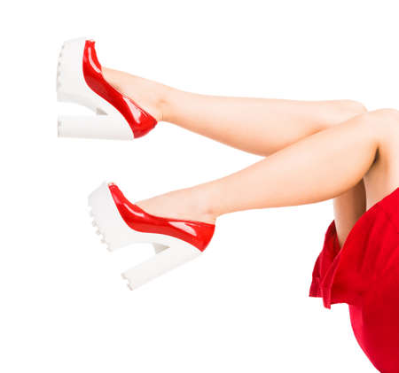 feet up: beautiful woman legs in red shoes with feet up