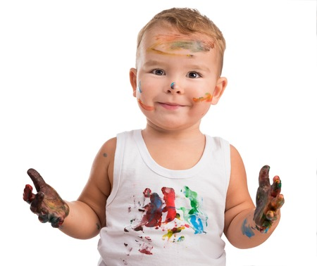 kids painted hands: excited little boy with painted face and isolated on a white background