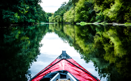 canoeing: boat nose on a calm river background