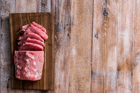 pork: big piece of raw meat on table Stock Photo