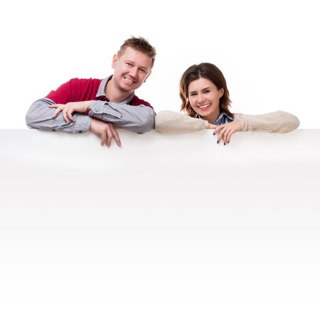 lean on hands: smiling couple lean on empty blanket for ad isolated on white background Stock Photo