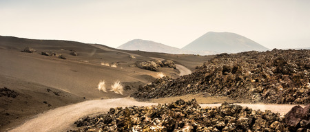 timanfaya: beautiful landscape with mountain road in Timanfaya National Park in Lanzarote, Canary Islands