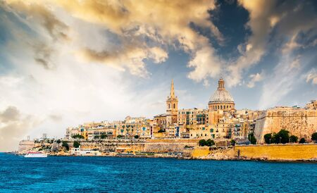 waterfront: scenic View of Marsamxett Harbour and Valletta in Malta at sunset