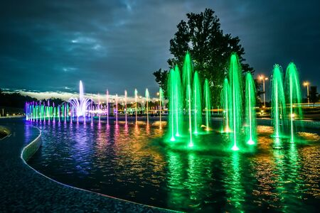 fountain: colorful illuminated musical fountain in Warsaw at dusk
