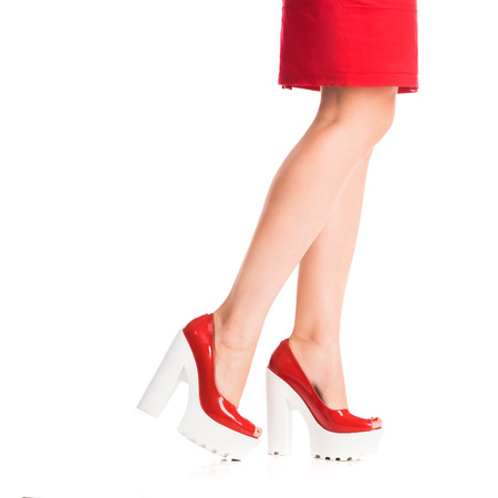 smooth: beautiful girls legs in shoes and red skirt