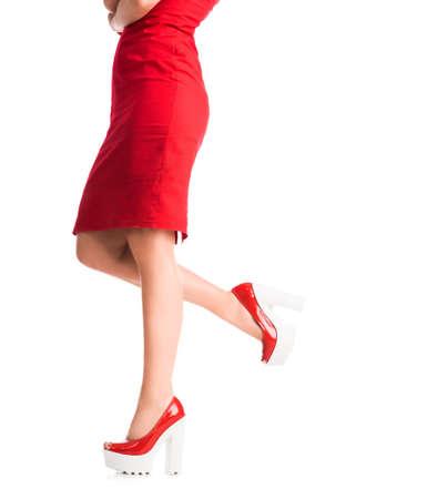slim girl: girl legs on heels with one leg lifted