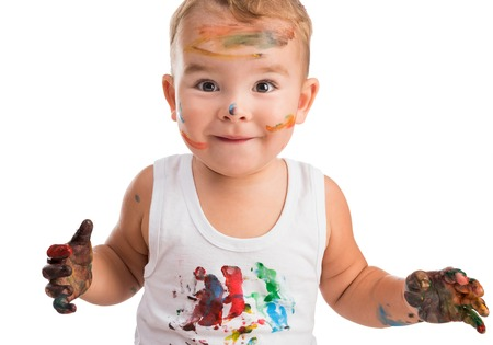 excited little boy with painted face and isolated on a white background