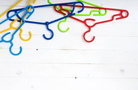 text space: set of colorful plastic clothes hangers with text space Stock Photo