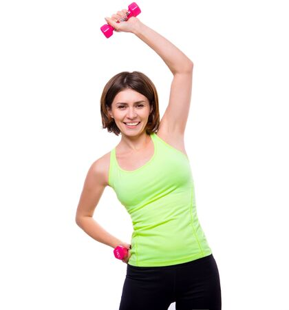 bends: sport woman doing side bends with dumbbells isolated on white background