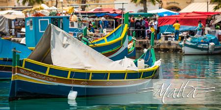 horison: postcard with colorful fishing boat in the bay near Marsaxlokk in Malta