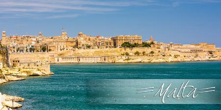 horison: postcard with amazing coastal architecture of Valletta in Malta from the sea Stock Photo