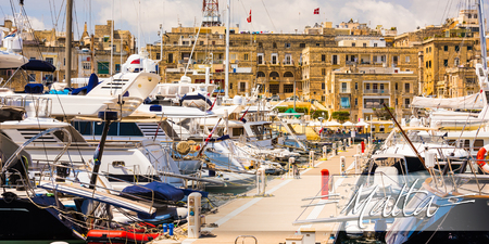 horison: postcard with yachts in Valleta port on the background of the city in Malta